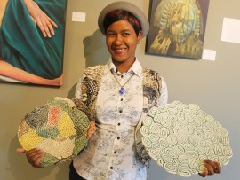 Nancy Ndaba  with some of her artwork.