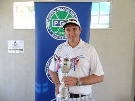 Pieter Kruger boasts his trophy as the new champion of the Soweto Golf Cup.