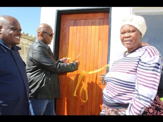 Sello Chipu and MEC for Human Settlements Joshua Ngonyama hand over a house to Flora Mooki. Photo Stephe Selaluke