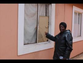 Jane Mahlangu (53) points to the broken window. Photo Stephen Selaluke