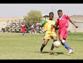 Thabiso Letsoalo of Maphius United tackles Sandile Ndala of No Fear Boys. PHOTO: Ron Sibiya