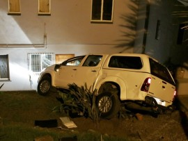 The vehicle rolled down the small embankment into the victims' front yard, coming within metres of smashing into their home