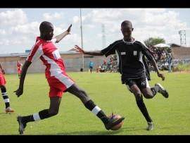 Richard Chueu (Mahube Stars) stops Samuel Tlammama (Happy Spurs) in his tracks. Photo: Ron Sibiya