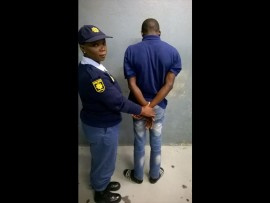 Constable Rosetta Kapari with the suspect who murdered a teenager and and injured two other people at a tavern in Hammanskraal.
