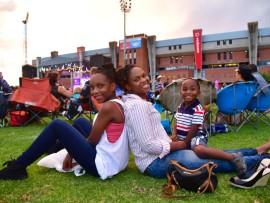Family enjoying relaxed atmosphere at Carols - from left to right: Andiswa, Okuhle, and Lwazi Mjadu. Photo: Nadia Rynners
