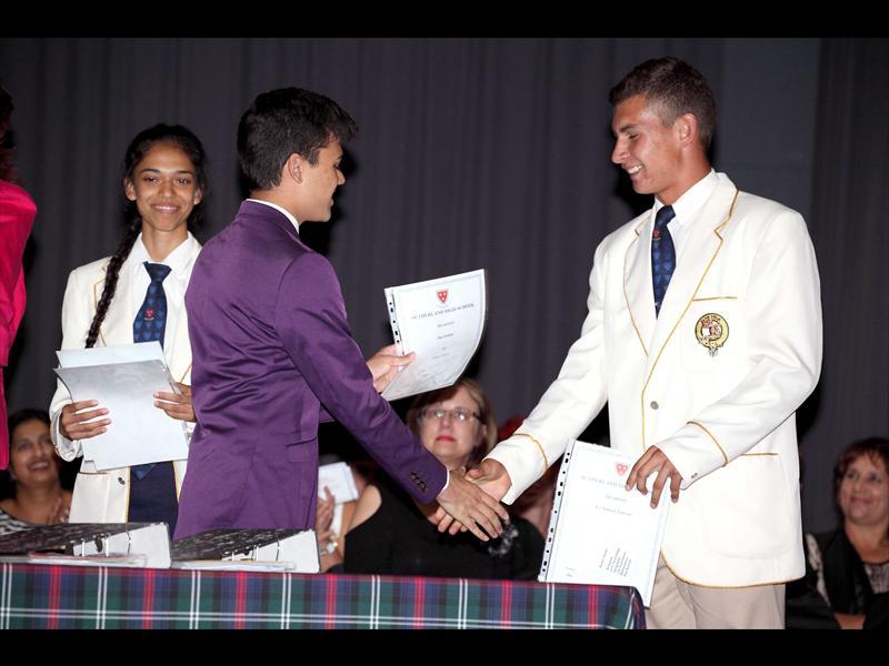 K Moosa, M Omar Carrim (purple jacket) and Sutherland High School head boy Ruben Venter receive awards. Photo: Supplied