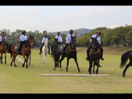 The police horseback unit put on a demonstration. Photo: Eliot Mahlase
