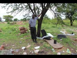 Security guard Solly Makonyane at the Jan Niemandpark dump. Apparently someone lives among the waste. Photo: Kayla van Petegem