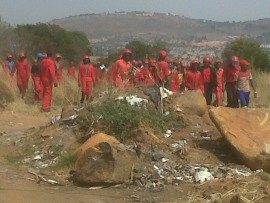 Red Ants remove illegal land grabbers in Wilgespruit on 30 August.