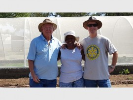 Andrew Robinson, Didi Mojapelo and Clive Smedmor work together as a team to make the vegetable gardens a success. Photo supplied.