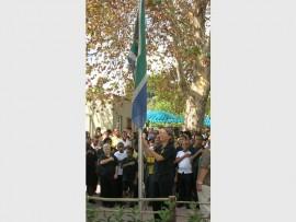 The departmental head of the junior school, Lindi van Vuuren, hoists the South African flag. Photo supplied.