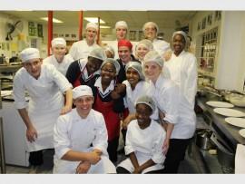 The hospitatlity class prepares to serve their international cuisine.