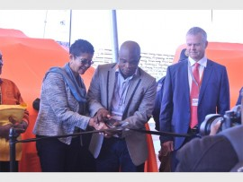 MMC for Transport Christine Walters, MMC for Public Safety Sello Lemao, JRA managing director Sean Phillips cut the ceremonial ribbon during the IPU launch.  Photo supplied.