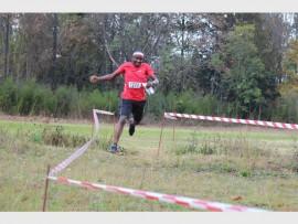 Epraim Chuene runs to the finish line at the orienteering event. Photo Supplied.