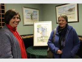 Locals, Antoinette van Wyk and Annerine Retief admire the artwork on exhibition.