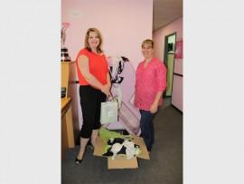 The Bra Guru –Tarryn Palacios donates hundreds of bras to the PinkDrive marketing manager, Febe Meyer.
