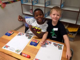 Ryan Staples and Luke Dunnington enjoy their colouring in projects. Photo: Supplied.