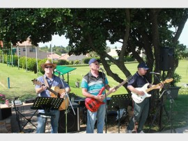 The Bluez Line Band entertain at lunch. The band members are John Evans, Duncan Foley and Brian Gallaghar.