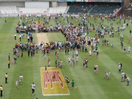 The crowd spends lunch on the field.