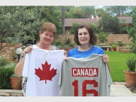 South African Marshagne Smith and Canadian Karen Macleod with the T-shirts that Macleod brought for Smith's children.